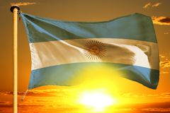 Argentina flag weaving on the beautiful orange sunset with clouds background. Argentina flag weaving on the beautiful orange sunset background royalty free stock photography