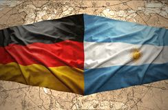 Argentina and Germany. Waving Argentinean and German flags on the background of the political map of the world Stock Images