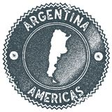Argentina map vintage stamp. Retro style handmade label, badge or element for travel souvenirs. Dark blue rubber stamp with country map silhouette. Vector Stock Photos