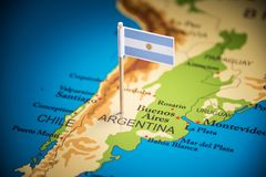 Argentina marked with a flag on the map.  royalty free stock photography