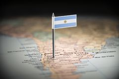 Argentina marked with a flag on the map.  stock images