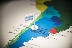 Argentina marked with a flag on the map.  royalty free stock images