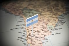 Argentina marked with a flag on the map.  royalty free stock image