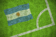 Argentina national flag. Against corner of football pitch Stock Image