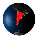 Argentina in red on Earth isolated on white Royalty Free Stock Photography