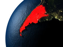 Argentina in red on Earth at night Royalty Free Stock Photos