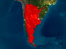 Argentina in red at night. Satellite night view of Argentina highlighted in red on planet Earth. 3D illustration. Elements of this image furnished by NASA Royalty Free Stock Photo