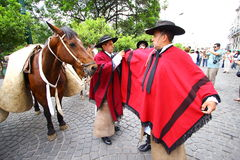 Argentina riders in red cape. Riders fixing their red cape in Salta, Argentina Stock Photos