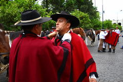 Argentina riders in red cape. Riders fixing their red cape in Salta, Argentina Stock Images