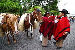 Argentina riders in red cape. Riders fixing their red cape in Salta, Argentina Royalty Free Stock Photo