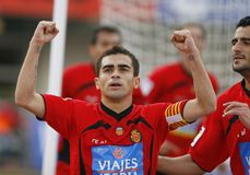 Argentina soccer player Ariel Ibagaza celebration after scoring a goal. Real Mallorca player Argentinian Ariel Ibagaza Guiza gestures after scoring a goal during Royalty Free Stock Photography