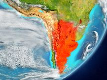 Argentina from space. Satellite view of Argentina highlighted in red on planet Earth with clouds. 3D illustration. Elements of this image furnished by NASA Royalty Free Stock Images