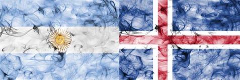 Argentina vs Iceland smoke flag. Isolated on a white background Royalty Free Stock Photo