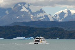 Argentine excursion ship. Near the Perito Moreno Glacier in Patagonia, Argentina Royalty Free Stock Photos