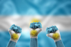 Argentine fans. Celebrating the victory of their country in competition stock images
