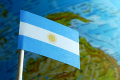 Argentine flag with a globe map as a background Royalty Free Stock Photos