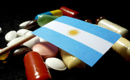 Argentine flag with lot of medical pills isolated on black Royalty Free Stock Images