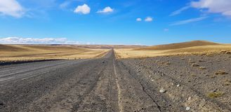 Argentine Patagonia road crossing a typical landscape, Patagonia, Argentina stock images