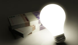 Argentine peso stack with shiny lightbulb Royalty Free Stock Photos