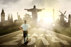 Argentine player standing on the road to brazil Royalty Free Stock Photos