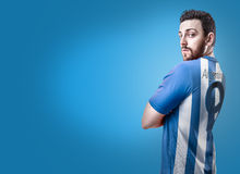 Argentine soccer player on blue background Royalty Free Stock Image
