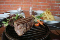 Argentine steak. Juicy Argentine steak with wine and french fries Stock Photography