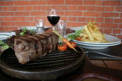 Argentine steak. Juicy Argentine steak with wine and french fries Royalty Free Stock Image