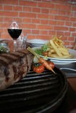 Argentine steak. Juicy Argentine steak with wine and french fries Stock Images