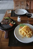 Argentine steak. Juicy Argentine steak with wine and french fries Royalty Free Stock Images