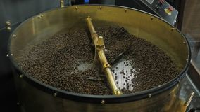Argentinean dark coffee beans are roasted and mixed on a special machine.  stock video
