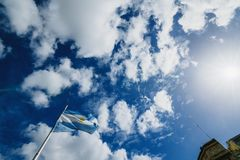 Argentinean flag flying in the wind against the background of the sky in the center of Buenos Aires royalty free stock photos