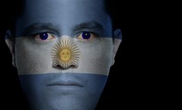 Argentinean Flag - Male Face. Argentinean flag painted/projected onto a man's face Royalty Free Stock Image
