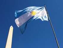 Argentinean Flag and Obelisk. The Argentinean Flag with the Obelisk of Buenos Aires next to it stock photos