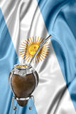 Argentinean mate1. Over an argentinean flag Stock Images