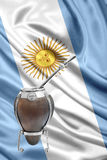 Argentinean mate. Over an argentinean flag Royalty Free Stock Photos