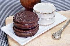 Argentinean-uruguayan alfajores and mate. A plate with argentinean-uruguayan alfajores and a mate infusion in a mate recipient Stock Photography