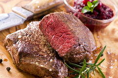 Argentinian Beef Steaks. As closeup on a wooden plate Royalty Free Stock Photos