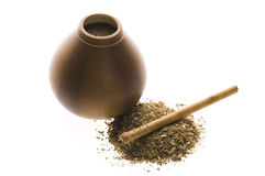 Argentinian calabase with yerba mate. Argentinian calabash with yerba mate isolated on white background Royalty Free Stock Image