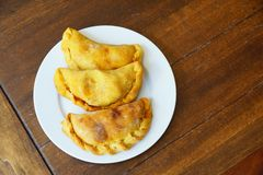 Argentinian empanadas. Served on a white plate Stock Photography