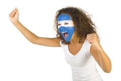 Argentinian fan. Young screaming Argentinian fan with painted flag on face. White background, side view Stock Photos