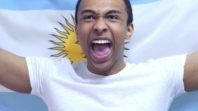 Argentinian Fan celebrates holding the Flag of Argentina in Slow Motion royalty free stock photography