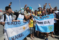 Argentinian fans support Grand Slam champion Juan Martin Del Potro of Argentina before men`s singles final of the Rio 2016 Olympic. RIO DE JANEIRO, BRAZIL Stock Photos