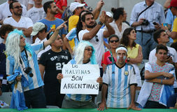 Argentinian fans support Grand Slam champion Juan Martin Del Potro of Argentina during men`s singles tennis final of the Rio 2016. RIO DE JANEIRO, BRAZIL Royalty Free Stock Images