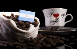 Argentinian flag in a bag with coffee beans isolated on black Royalty Free Stock Image