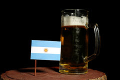 Argentinian flag with beer mug isolated on black Stock Images