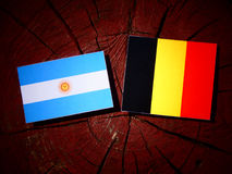 Argentinian flag with Belgian flag on a tree stump isolated Royalty Free Stock Photography