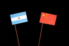 Argentinian flag with Chinese flag isolated on black Stock Photography