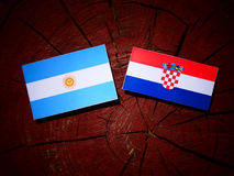 Argentinian flag with Croatian flag on a tree stump  Royalty Free Stock Photos