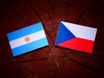 Argentinian flag with Czech flag on a tree stump isolated Royalty Free Stock Photography