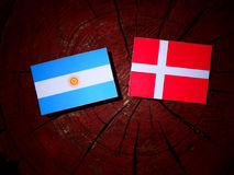 Argentinian flag with Danish flag on a tree stump isolated Stock Photo